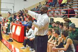 Metro-East Lutheran coach Anthony Smith gives instructions from the sideline during his team's road game against Staunton on Tuesday.