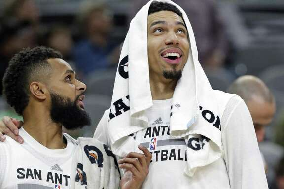 Danny Green and Patty Mills check the scoreboard as the Spurs pull off a 40-point win over the Lakers at the AT&T Center on Jan., 12, 2017.