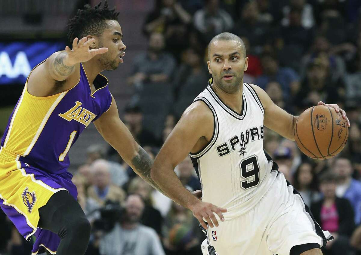 Tony Parker eyes movement in the lane as he drives on D'Angelo Russell on Jan. 12, 2017.