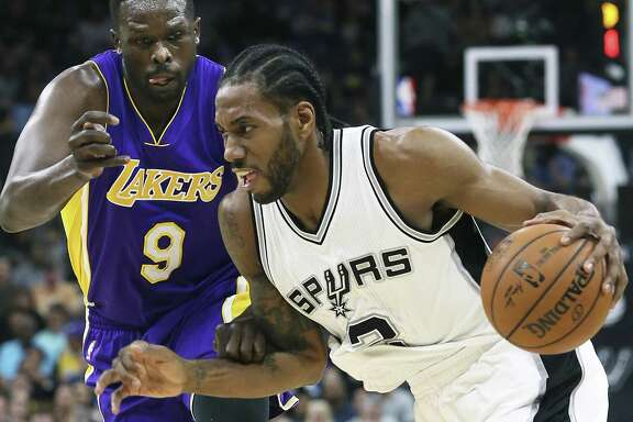 Kawhi Leoanrd makes a move to the lane against Luol Deng as the Spurs host the Lakers at the AT&T Center on January, 12, 2017.
