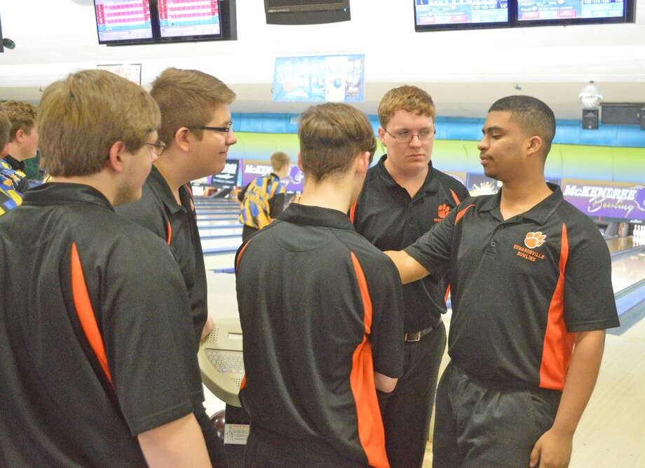 Members of the Edwardsville boys' bowling team gather during a dual match against O'Fallon at St. Clair Bowl on Wednesday. The Tigers will participate in the Salem Regional.