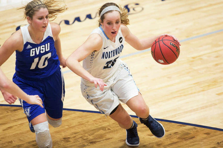 THEOPHIL SYSLO | For the Daily News Northwood's Lindsay Orwat controls the ball while being defended by Grand Valley State's Taylor Lutz in a game at Northwood University on Thursday.