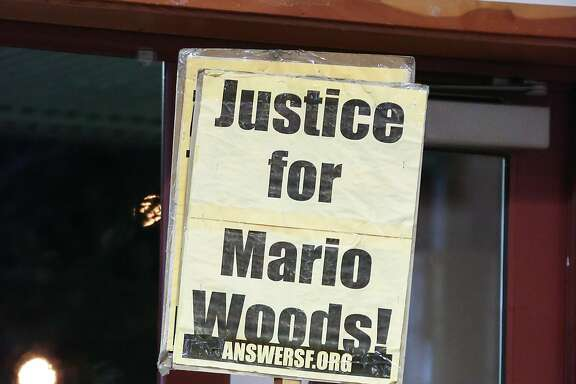 A man holds a sign in support of Mario Woods at the town hall meeting on January 12, 2017 to update the public about an officer involved shooting of an unarmed man that occurred on January 6th on the 500 block of Capitol Avenue in San Francisco, Calif.