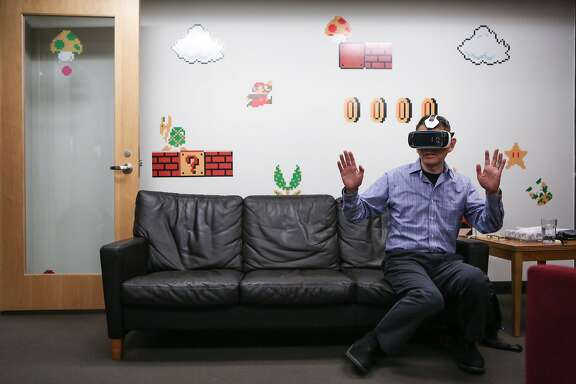 Adobe Research principal scientist Walter Chang gives a demonstration of Adobe's virtual reality version of a PDF at the Adobe headquarters on January 12, 2017 in San Francisco, Calif.