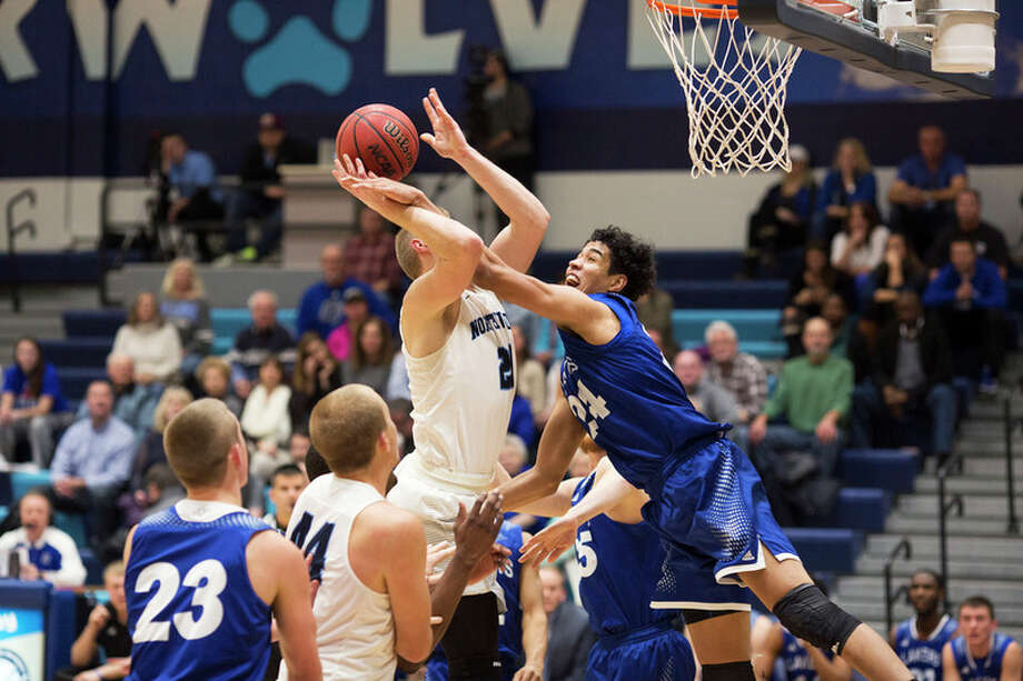 THEOPHIL SYSLO | For the Daily News Northwood's Zach Allread attempts the shot while being fouled by Grand Valley State's Justin Greason in a game at Northwood University on Thursday.