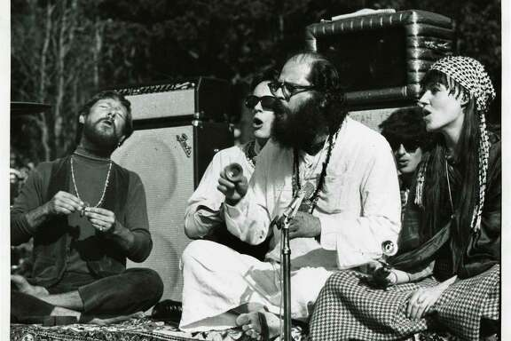 Gary Snyder (left), Michael McClure and Allen Ginsberg participate in the Human Be-In with other celebrants.