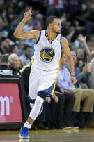 Golden State Warriors guard Stephen Curry (30) celebrates a three-point-shot during the second half of an NBA basketball game between the Golden State Warriors and the Detroit Pistons on Thursday, Jan. 12, 2017, at the Oracle Arena in Oakland, Calif. The Warriors won 127-107.