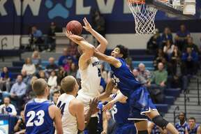 Northwood's Zach Allread attempts the shot while being fouled by Grand Valley State's Justin Greason in a game at Northwood University on Thursday.