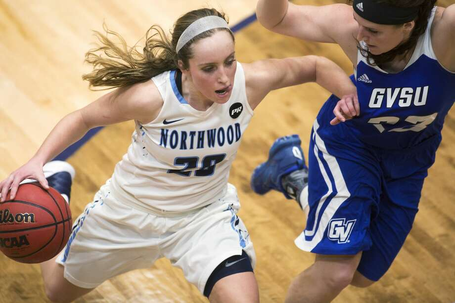 Northwood's Lindsay Orwat controls the ball while being defended by Grand Valley State's Kayla Dawson in a game at Northwood University on Thursday. Photo: Theophil Syslo