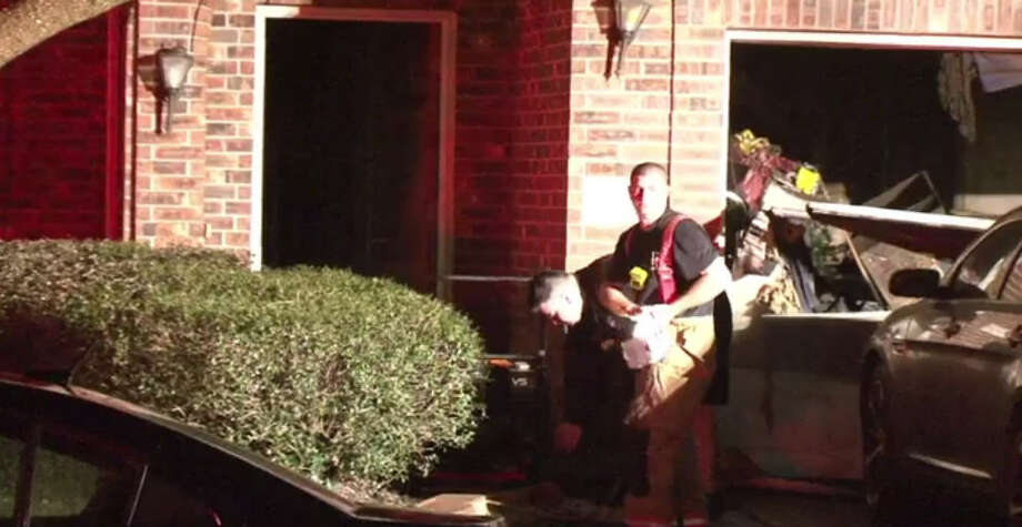 A fire damaged a garage at a home about 4 a.m. Friday Jan. 13, 2017, at near Stansberg at Oak Falls in northwest Harris County. (Metro Video)