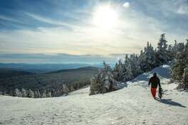 A snowboarder near the top of Killington resort in Vermont.