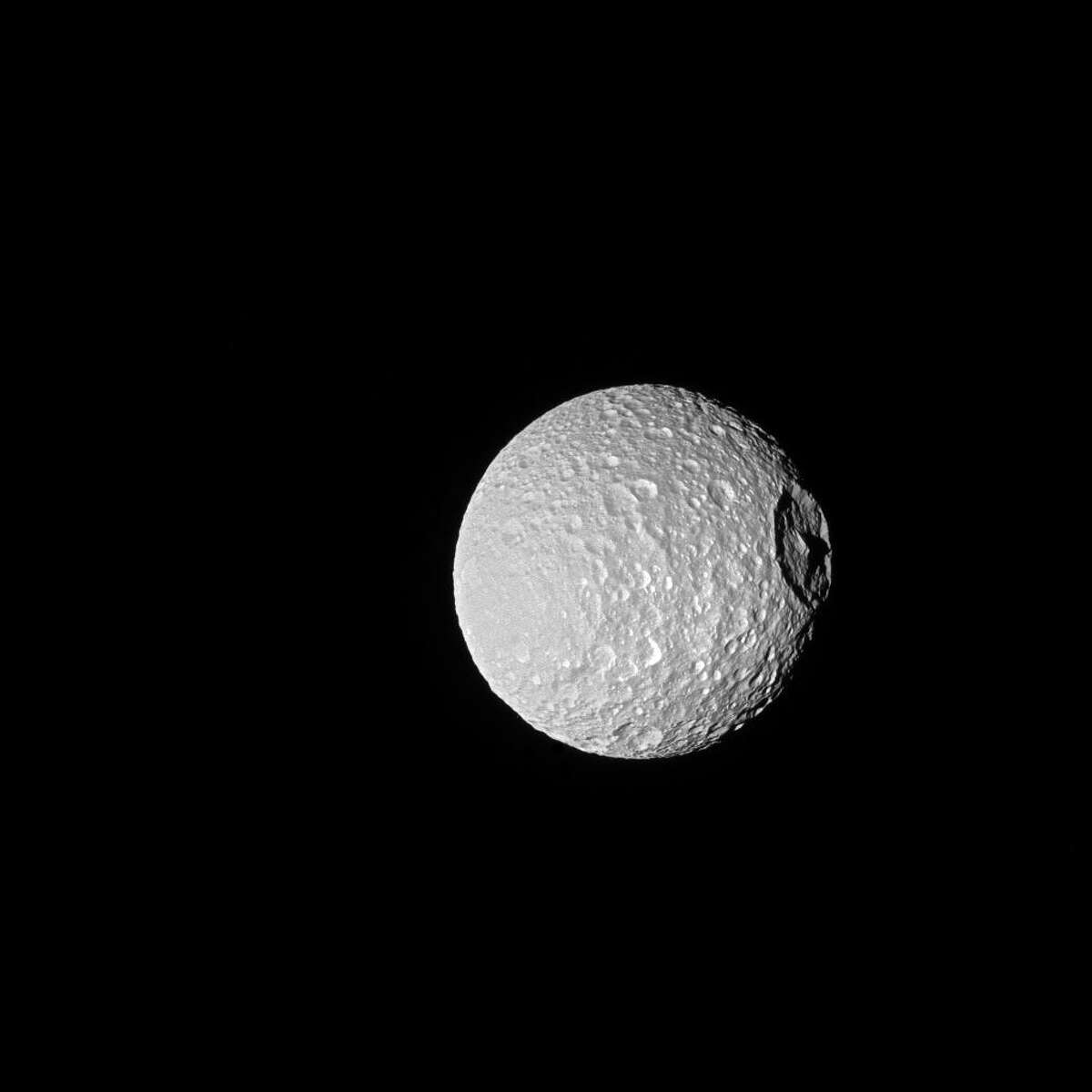 """PHOTOS: Saturn and her moons up-close """"Mimas,"""" one of Saturn's moons which resembles the Death Star. Click through to seeNASA's latest images that show how astonishingly large Saturn's rings are."""