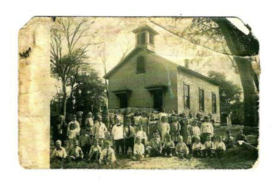 Staff and students outside Westport's Cross Highway School in this undated photo. Photo: Contributed Photo / Westport News