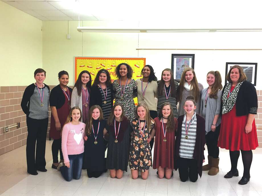 Members of Liberty Middle School seventh-grade girls' basketball team were honored Monday at the Edwardsville District 7 Board of Education meeting. The Panthers recently completed an undefeated conference season while winning regional, sectional and state championships. Photo: Julia Biggs • Intelligencer