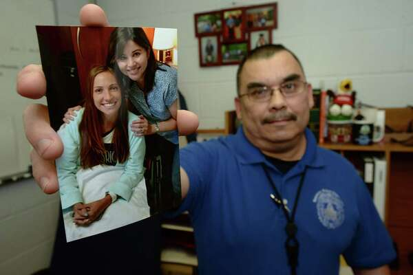 Beaumont Police Officer Danny Valdez holds out a picture of Ashley Settles, pictured left, who donated a kidney to him. Valdez wife Kathy Valdez is pictured with Settles the day of the transplant.  Photo taken Wednesday, January 11, 2017 Guiseppe Barranco/The Enterprise