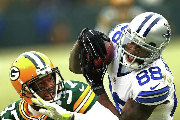 Dallas Cowboys wide receiver Dez Bryant makes a would-be catch over Green Bay Packers cornerback Sam Shields late in the fourth quarter on Jan. 11, 2015, at Lambeau Field in Green Bay, Wis. The play was ruled a catch but was overturned via instant replay.