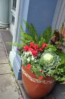 Pots and window boxes add life to the winter landscape.