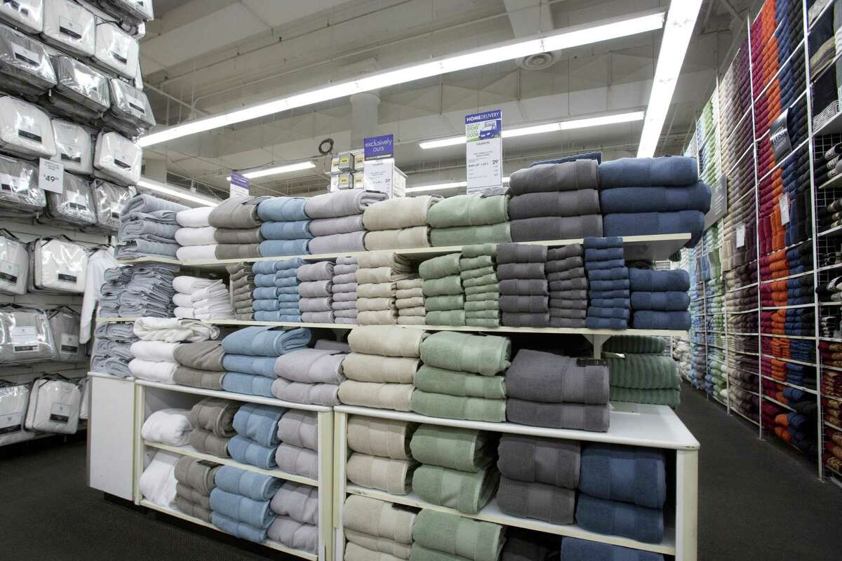 Towels are stacked at a Bed Bath & Beyond in New York. Department stores saw their inventories and sales decline between November and October, part of a broader long-term slowdown as shoppers move to online retailers.