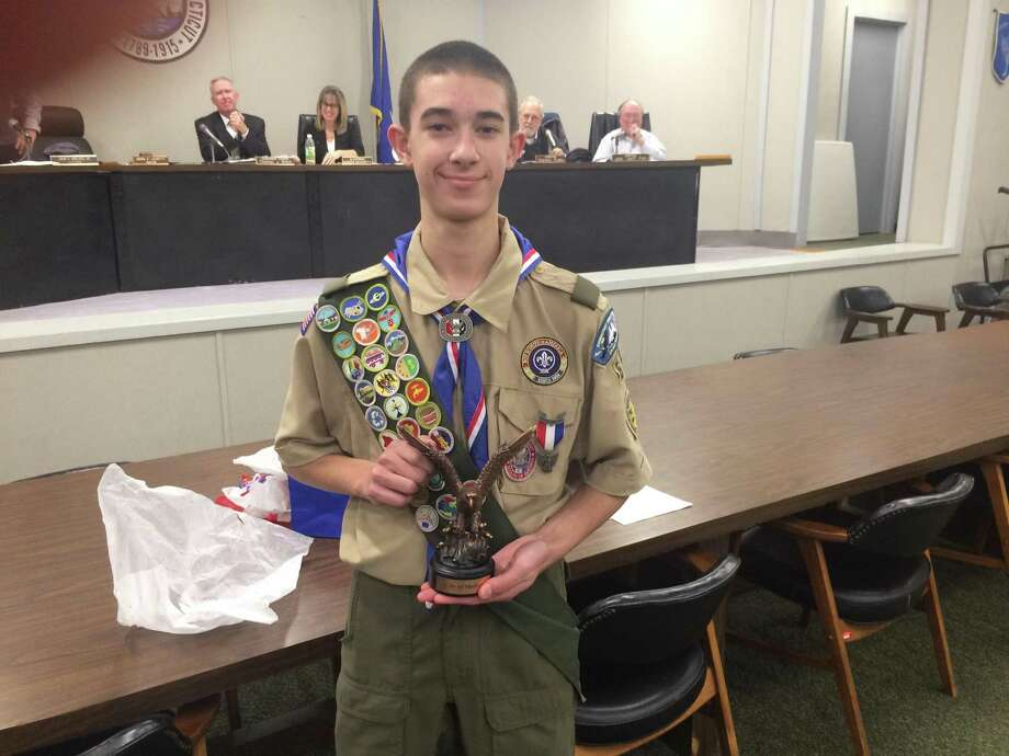 Peter Sandri, a 15-year-old Shelton resident and new Eagle Scout displays a bronze Eagle statue Mayor Mark Lauretti gave him during the Jan. 12, 2017 Board of Aldermen meeting Photo: / Michael P. Mayko