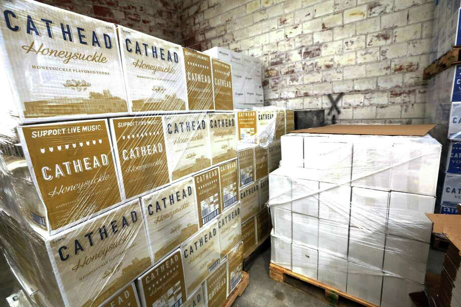 A pallet of honeysuckle-flavored vodka is ready for shipping out of the Cathead Distillery in Jackson, Miss. The producer price index, which measures price changes before they reach consumers, increased 1.6 percent last year, the Labor Department said Friday. That's the biggest 12-month gain since September 2014. Still, it is low historically and suggests inflation is largely in check. Photo: Associated Press /File Photo / Copyright 2016 The Associated Press. All rights reserved. This material may not be published, broadcast, rewritten or redistribu