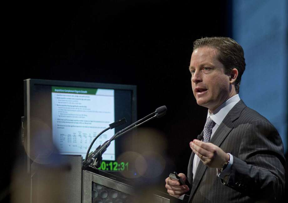 Tony Sanchez, CEO for Sanchez Energy Corp., is shown speaking at the 2013 Hart Energy DUG Eagle Ford conference in San Antonio. Sanchez said late Wednesday it would buy Anadarko's acreage on the western edge of the Eagle Ford. Photo: Bloomberg News /File Photo / © 2013 Bloomberg Finance LP