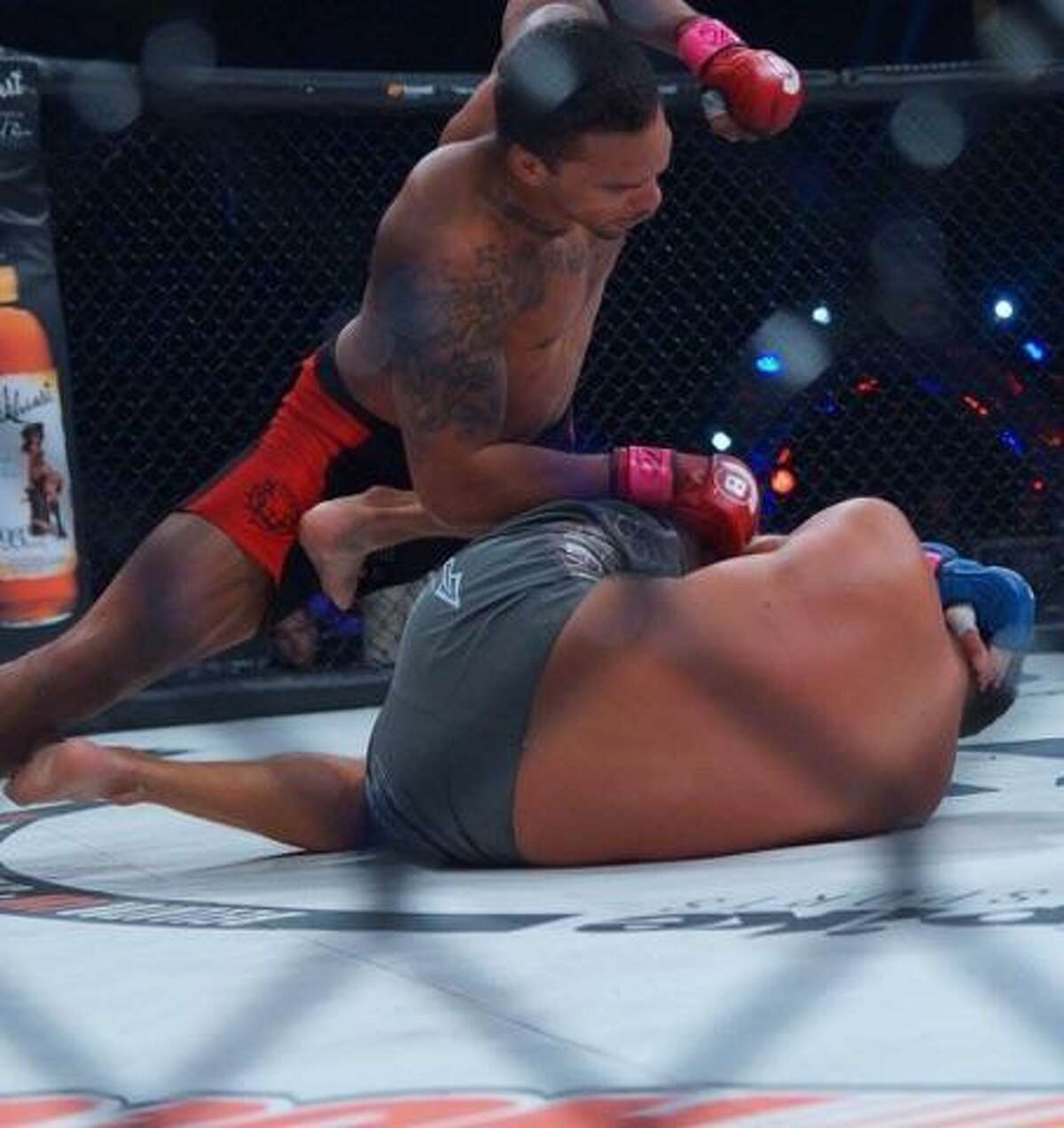 Eryk Anders (top), a former Smithson Valley High School and Alabama linebacker, pummels Brian White during their Bellator MMA fight on Oct. 21, 1206, at the FedEx Forum in Memphis, Tenn.