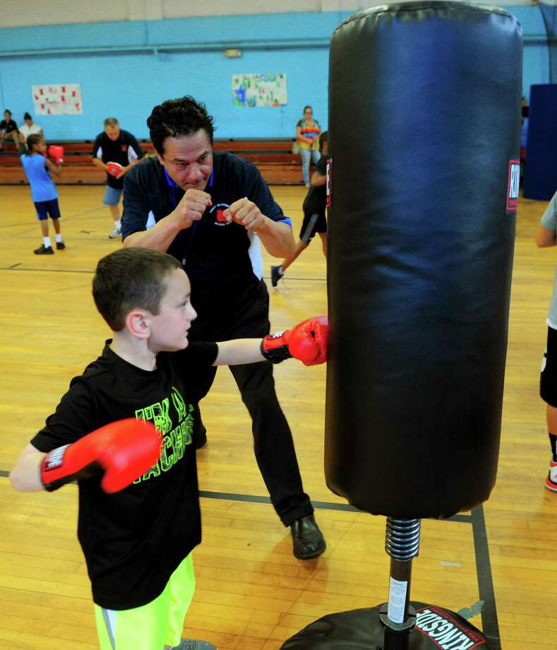 Mayor David Cassetti kicks off the Pinky Silverberg Boxing Club training program for boys and girls between ages 6 and 13 at the Ansonia Armory on North Cliff Street in Ansonia, Conn., on Thursday Sept 1, 2016. Photo: Christian Abraham / Hearst Connecticut Media / Connecticut Post