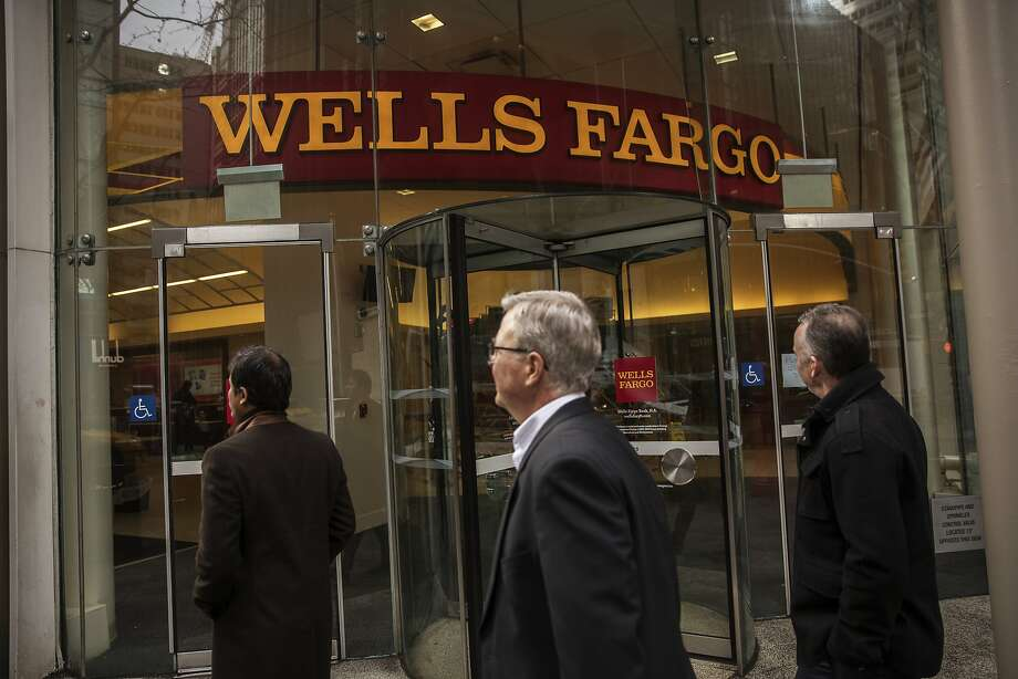 Pedestrians pass in front of a Wells Fargo & Co. bank branch in New York, U.S., on Wednesday, Jan. 11, 2017. Wells Fargo & Co. is scheduled to release earning figures on January 13. Photographer: Victor J. Blue/Bloomberg Photo: Victor J. Blue, Bloomberg