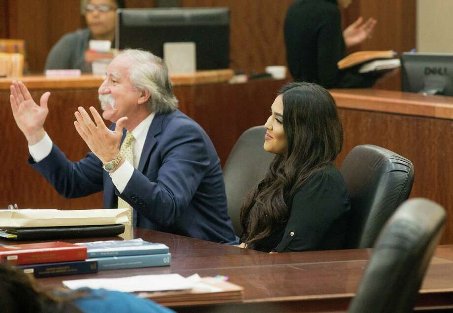 Alexandria Vera, 24,  a former Aldine ISD teacher arrives sits with her attorney Ricardo Rodriguez as they wait for her hearing to begin. Vera accepted a charge of aggravated sexual assault of a child, which has a maximum sentence of life in prison. However, under the plea deal, her possible punishment is capped at 30 years and she is eligible for deferred adjudication probation. Photo: Bob Levey, Houston Chronicle / ©2017 Bob Levey