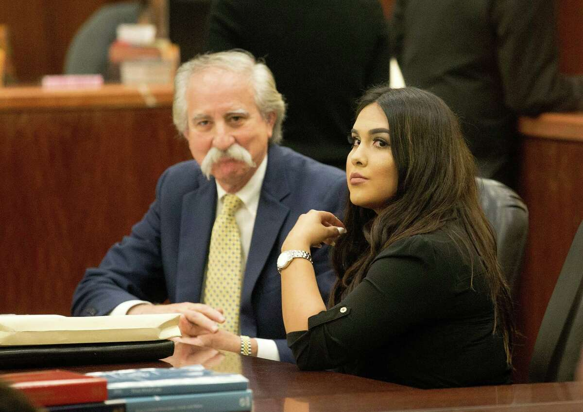 Alexandria Vera, 24, a former Aldine ISD teacher arrives sits with her attorney Ricardo Rodriguez as they wait for her hearing to begin. Vera accepted a charge of aggravated sexual assault of a child, which has a maximum sentence of life in prison. However, under the plea deal, her possible punishment is capped at 30 years and she is eligible for deferred adjudication probation.