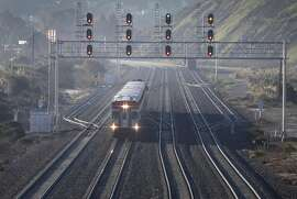 A northbound express train approaches the Bayshore Caltrain station in Brisbane, Calif. on Friday, Jan. 13, 2017.