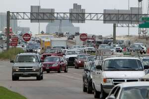 Traffic backs on 610 North headed west as construction work continues as the westbound U.S. 290 lanes from northbound Loop 610 are closed for construction through 5:00 a.m. Monday Saturday, July 12, 2014, in Houston. ( James Nielsen / Houston Chronicle )