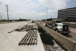 """The TxDOT construction of new westbound US 290 (left) and the old US 290  Wednesday, May 11, 2016, in Houston.  TxDOT will make a major traffic switch this weekend, changing the way drivers get from northbound Loop 610 to U.S. 290. """"We will switch the exit to US 290 from its current location on the left side of the freeway to the right side of the freeway.  The exit will be placed on a portion of the new IH 10 to US 290 connector, the part that is completed is from about W. 18th Street over to US 290.  So we'll move the US 290 exit to that portion of the connector with a temporary transition from the right side of IH 610 to the connector.  What this does is open up the US 290 westbound mainlanes from IH 610 to about W. 34th for crews to work on.""""  ( Steve Gonzales  / Houston Chronicle  )"""