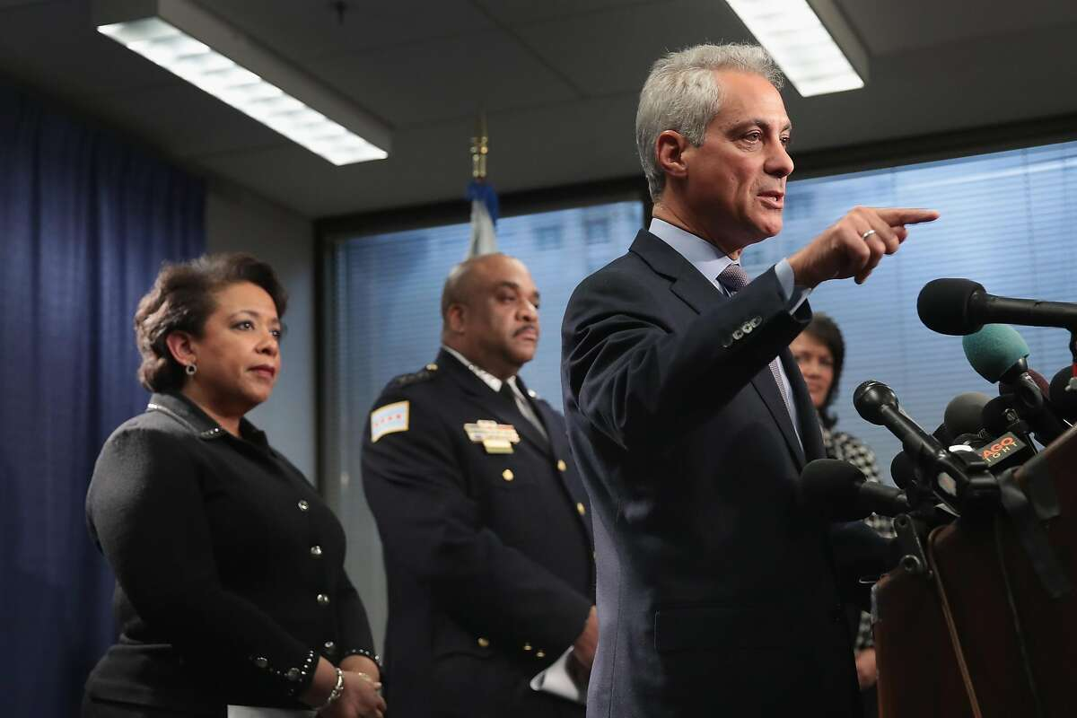 CHICAGO, IL - JANUARY 13: U.S. Attorney General Loretta Lynch (L) and Police Superintendant Eddie Johnson (C) listens as Chicago Mayor Rahm Emanuel speaks at a press conference on January 13, 2017 in Chicago, Illinois. U.S. Attorney General Loretta Lynch called the press conference to announce the release of a report which cited widespread abuses by officers in the Chicago police department following a 13-month investigation. (Photo by Scott Olson/Getty Images)