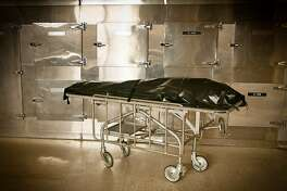 Body bag in a hospital morgue in black and white