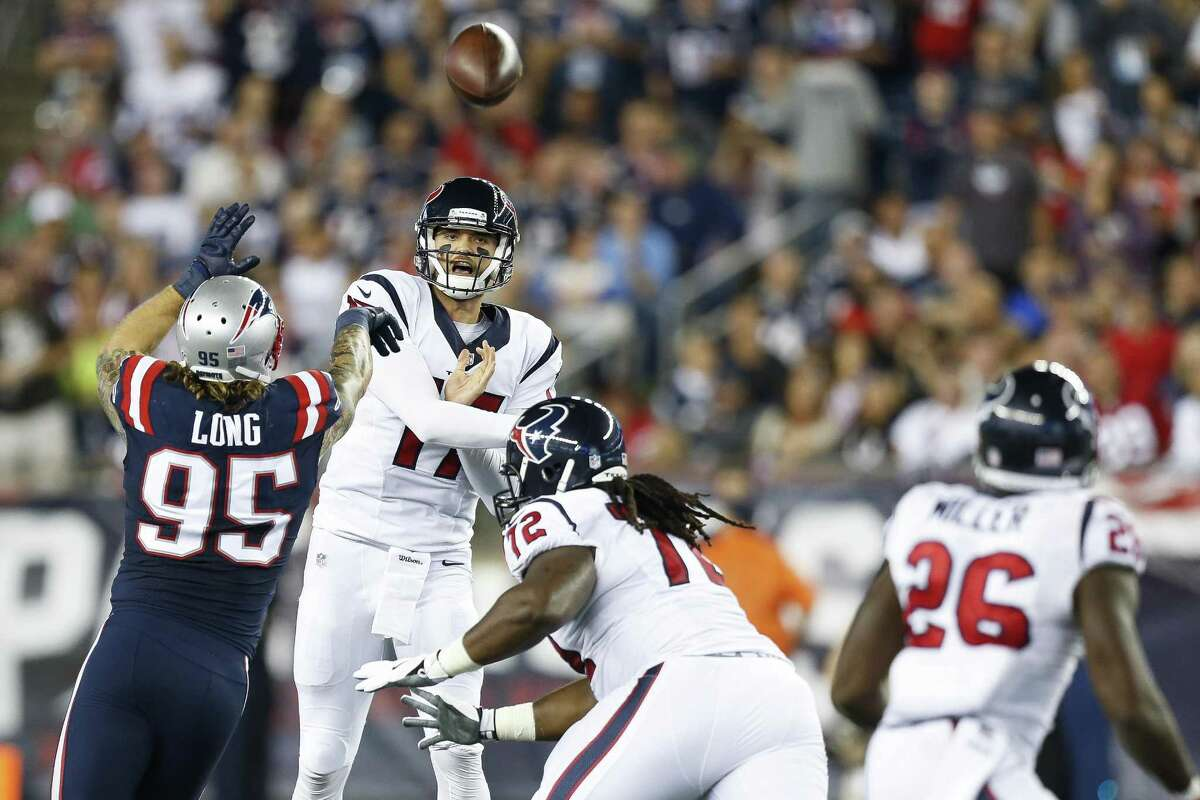 Houston Texans quarterback Brock Osweiler throws a pass over New England Patriots defensive end Chris Long (95) during the second quarter at Gillette Stadium on Sept. 22, 2016, in Foxborough, Mass.