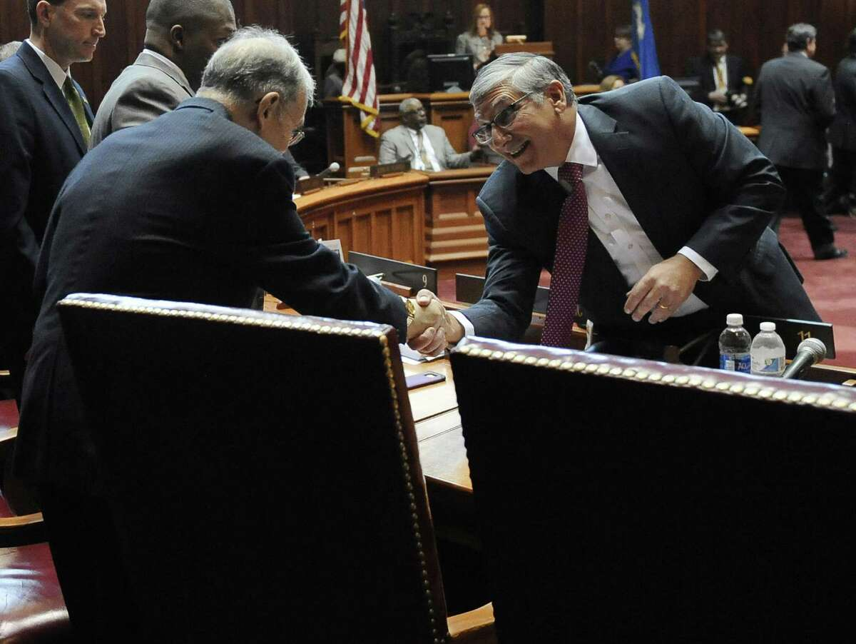 Senate Republican President Pro Tempore Len Fasano, R-North Haven, greets Senate President Pro Tempore Martin M. Looney, D-New Haven, right, during the opening session at the state Capitol. Gains by Republicans in last year's election could complicate a renewed push for paid family leave.
