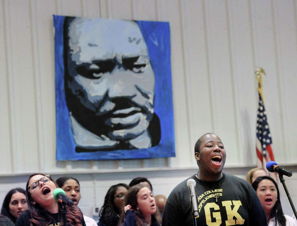 Concordia College GospelKnight Davin Thompson-Williams, right, leads the singing during the annual assembly and prayer service to honor the legacy and memory of Dr. Martin Luther King, Jr., at Sacred Heart Greenwich in Greenwich, Conn., Friday, Jan. 13, 2017. Civil and Human Rights Activist Joanne Bland was the keynote speaker for the event. The Concordia College GospelKnights Choir performed as did the Vision Steppers dance group.