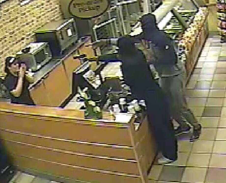 Surveillance photograph during an aggravated robbery about 9:30 p.m. Dec. 29 at the Subway located at 10150 Highway 6 South in Fort Bend County. Fort Bend County Sheriff's Office)