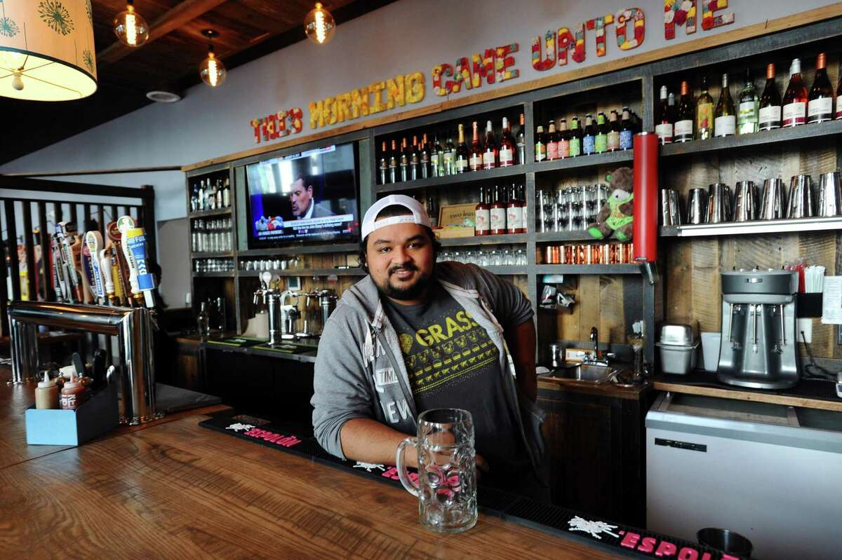 Bareburger bar manager Carlo Teo poses for a photo inside the Harbor Point restaurant in Stamford, Conn on Thursday, Jan. 12, 2017.