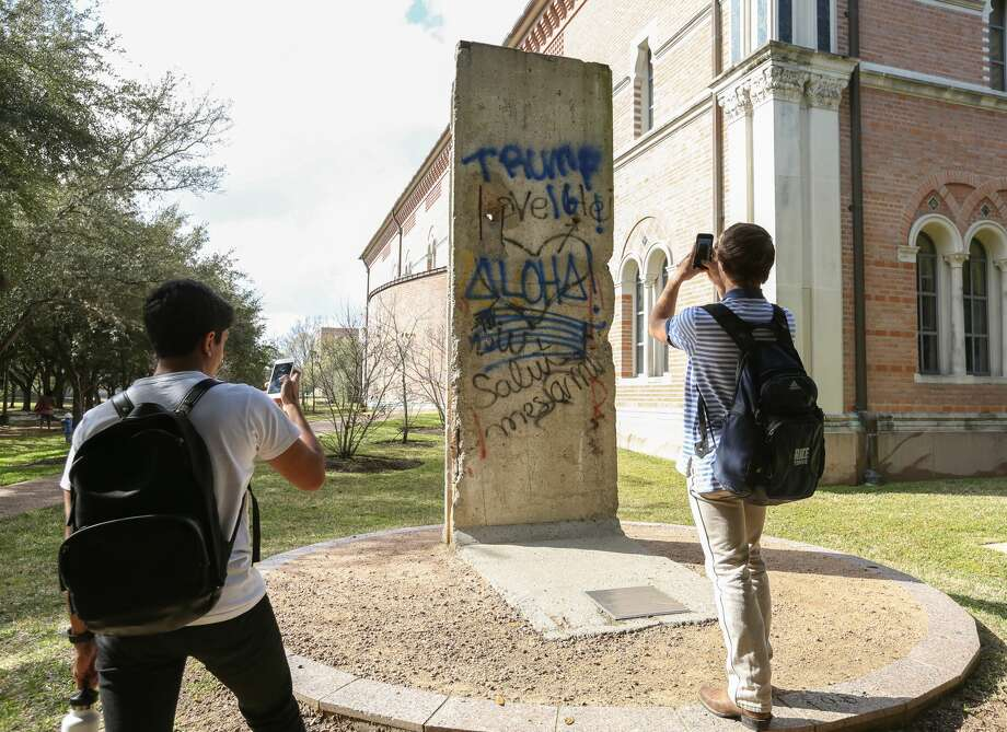 "Vandals spray painted and marked up several items at Rice University in Houston. The school says it has identified the students responsible.Rice University students Achal Srinivasan, left, and Jake Hansen take photographs of the vandalized Berlin Wall memorial outside Baker Institute for Public Policy on Friday, January 13, in Houston. The spray paint graffiti read ""Trump 16"" and ""Aloha!"" (Yi-Chin/ Houston Chronicle) Photo: Yi-Chin Lee / Houston Chronicle /Houston Chronicle"