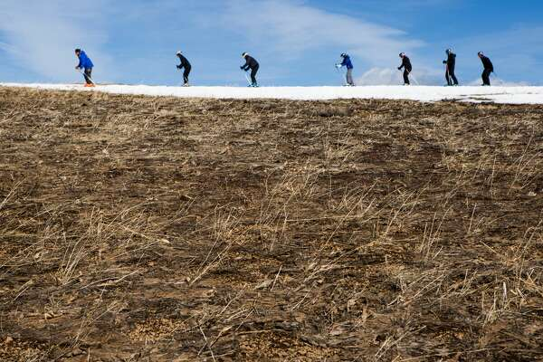 OLYMPIC VALLEY, CA- MARCH 21:  Skiers thread their way through patches of dry ground at Squaw Valley Ski Resort, March 21, 2015 in Olympic Valley, California. Many Tahoe-area ski resorts have closed due to low snowfall as California's historic drought continues. (Photo by Max Whittaker/Getty Images)