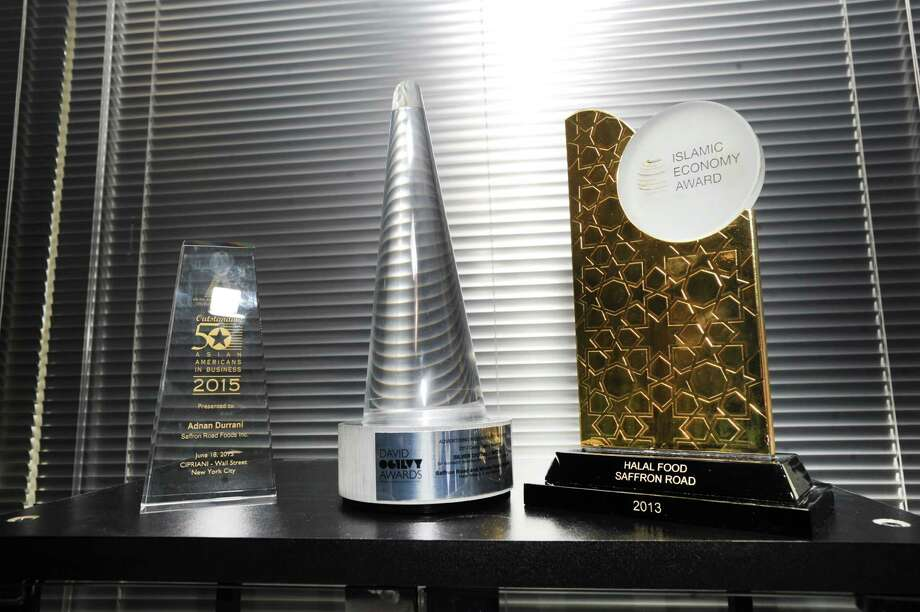 Some of the awards won by American Halal Company, Inc., that wholly owns Saffron Road, a leading natural frozen food and natural products brand, includes a David Ogilvy Award, center, as seen on a shelf at the company's office in Stamford, Conn., Friday, Jan. 13, 2017. Photo: Bob Luckey Jr., Hearst Connecticut Media / Greenwich Time