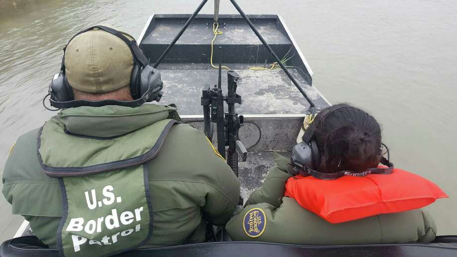 U.S. Border Patrol Agent Octavio Salazar and an 11-year-old Honduran girl after the girl was found on an island in the Rio Grande on Jan. 12, 2017, near Eagle Pass. Photo: Courtesy Photo / Border Patrol Agent Jose Diaz De Leon