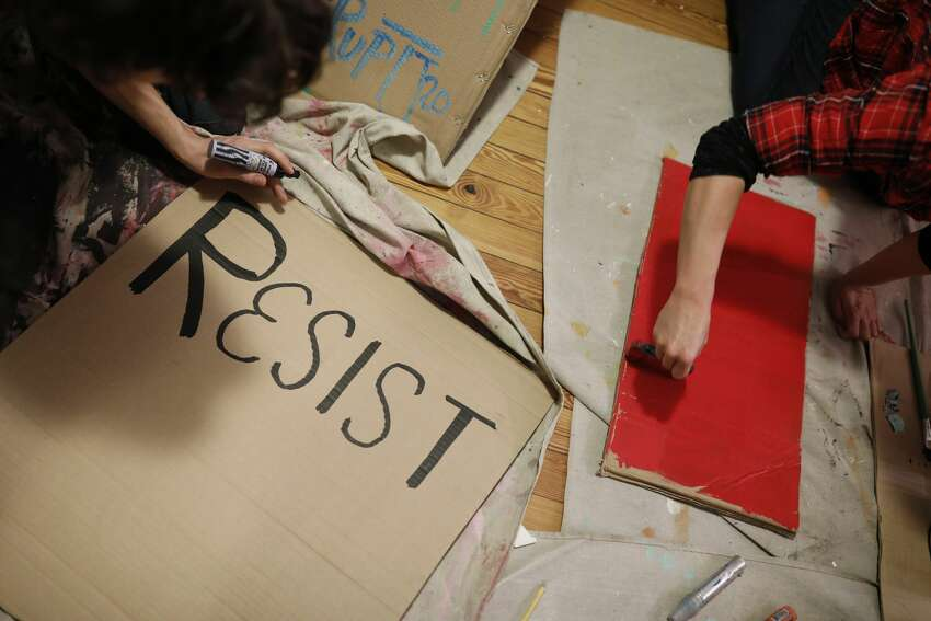WASHINGTON, DC - JANUARY 11: Activists gather to make signs for demonstrations against the upcoming inauguration of Donald Trump January 11, 2017 in Washington, DC. The Inauguration is expected to bring thousands of activists and supporters to Washington. (Photo by Aaron P. Bernstein/Getty Images)