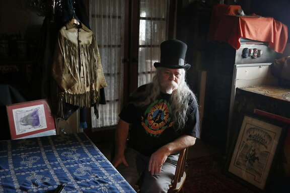 Rusty Goldman, who is also  known as Professor Poster, sits next to a fringe jacket he wore to the Human Be-In and artwork made for the  Human Be-In at his home on Monday, January 9,  2017 in Pacifica, Calif.