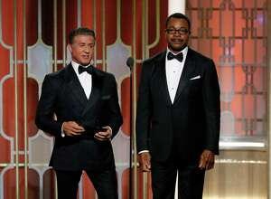This image released by NBC shows presenters  Sylvester Stallone, left, and Carl Weathers at the 74th Annual Golden Globe Awards at the Beverly Hilton Hotel in Beverly Hills, Calif., on Sunday, Jan. 8, 2017. (Paul Drinkwater/NBC via AP) ORG XMIT: NYET794