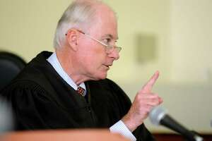 Superior Court Judge Robert Devlin of Shelton easily won confirmation to another eight-year term on Friday, after some lawmakers on the Judiciary Committee criticized him for the way he handled a sexual assault case last year.