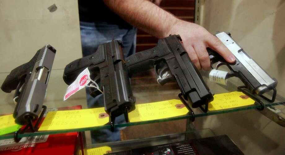 Pistols on display inside a Walnut Creek gun shop. Photo: Michael Macor, The Chronicle