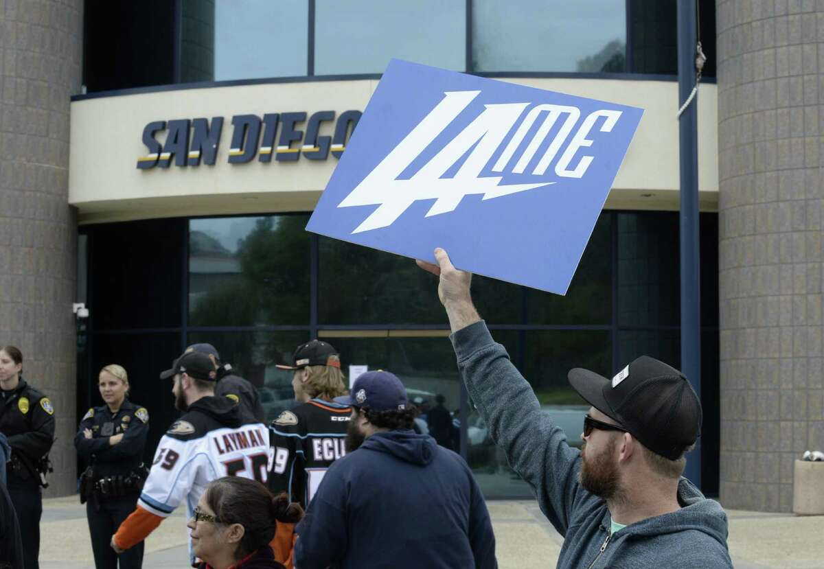 A San Diego Chargers fan holds up a sign in front of Chargers headquarters after the team announced that it will move to Los Angeles on Jan. 12, 2017, in San Diego.
